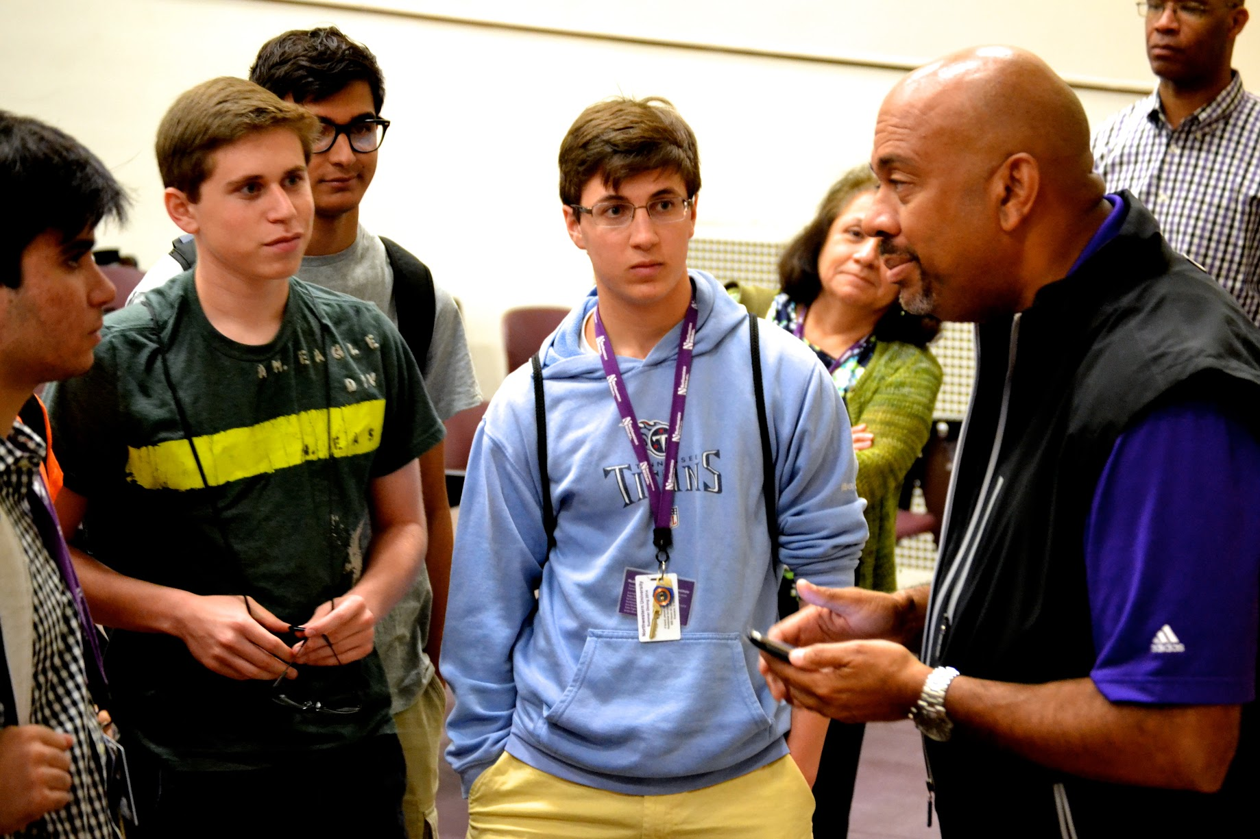 Mike Wilbon fielded questions after his Q-and-A session and kept talking sports during lunch. Listening, from left, are Jimmy Lafakis, Garrett Jochnau, Chris Grismer and Aaron Kaplan. Photo by Remy Afong.