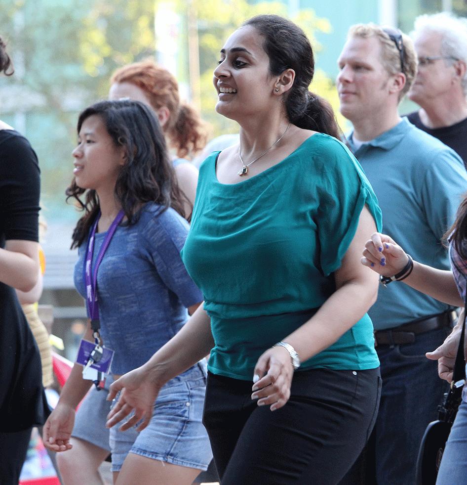 """Cherub Annie Cebulski (left) gets in line at """"It's Thursday, Let's Dance!"""" in Evanston. Photo by Robbie Short."""