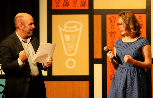 Peter Sagal and Paisley Meegan celebrate on stage at Wait Wait...Don't Tell Me! Photo by Marc Chappelle.