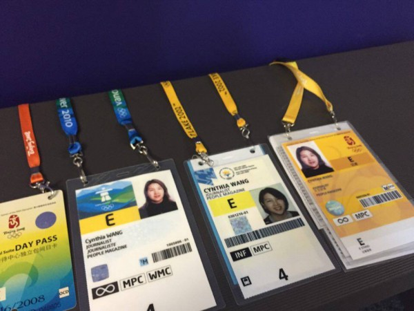 Cynthia Wang's media passes to past Olympics. Photo by Ellie Lieberman