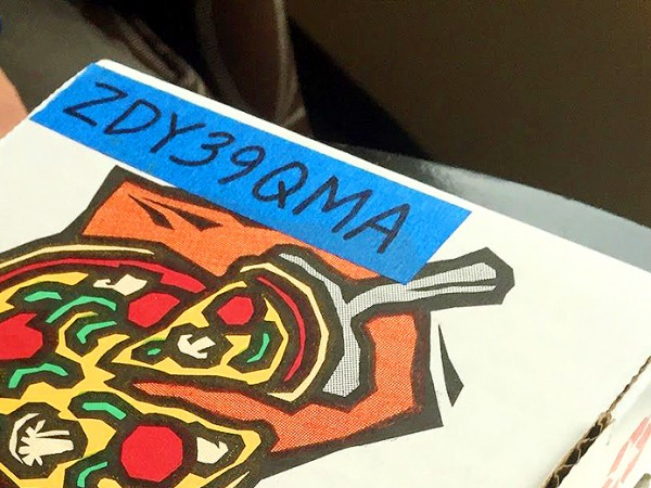 The pizza box with the 8-digit code. Photo by Amanda Rooker.