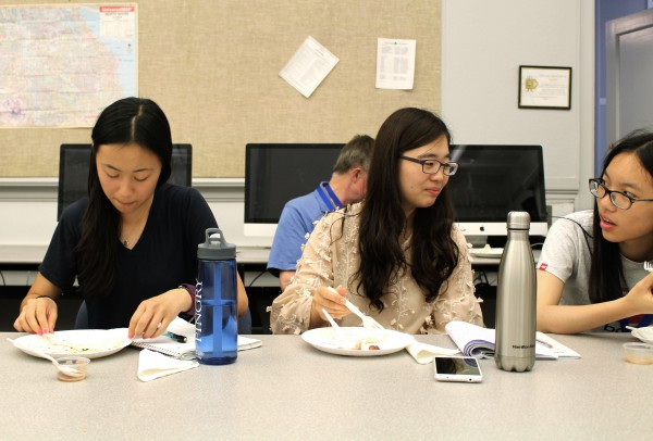 Katie Ho, Gina Kim and Nina Cong taste-test foods at the Writing about Food workshop.