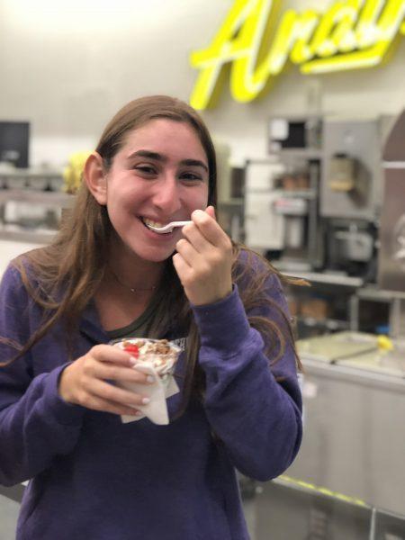 Girl eating custard at Andy's.