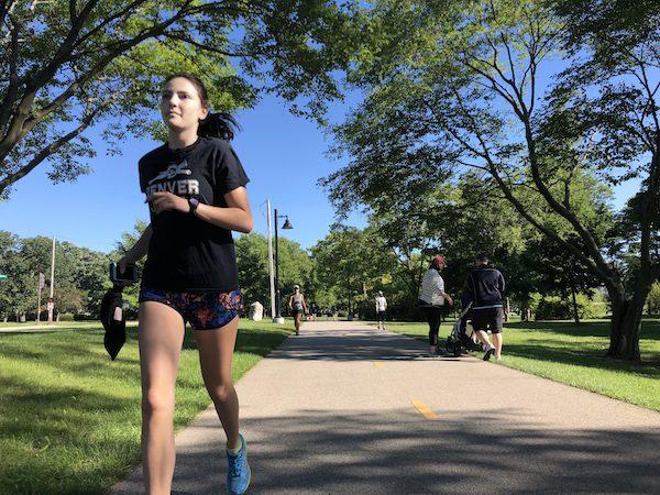 A girl runs at a park.