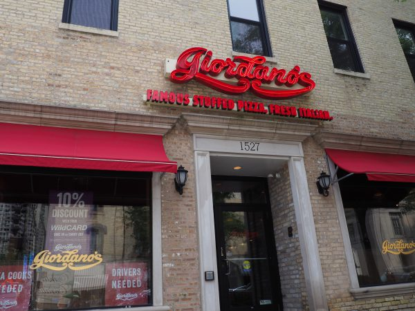 The front of a building with a red sign that says Giordano's.