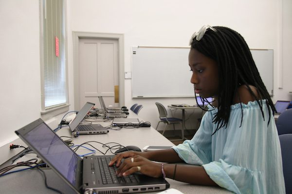 A girl types in the computer.
