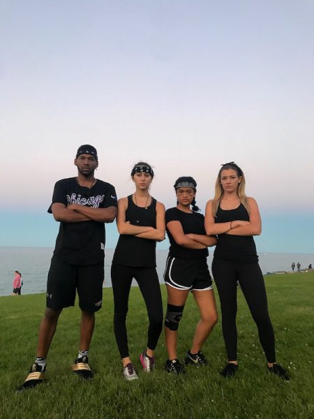 Community associates pose on the Lakefill after the Junior Junior Olympics dressed in black clothing.