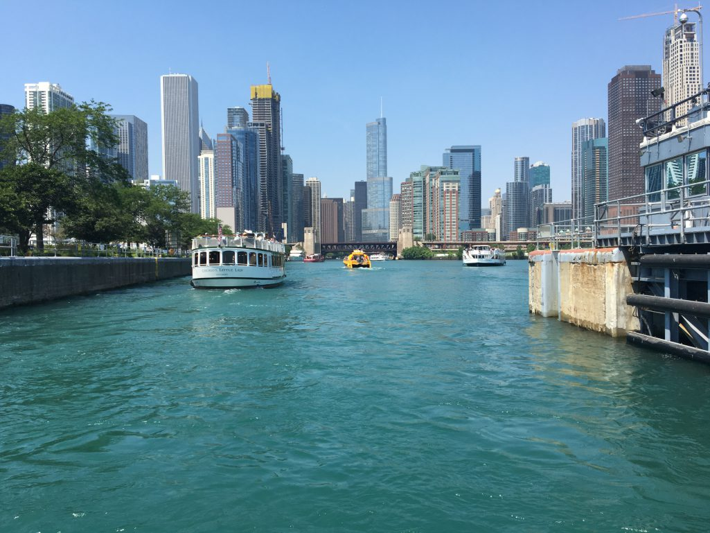 The Chicago River as seen from Lake Michigan looking east toward the city with three boats on the water