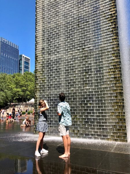 Sarah Meadow and Aidan Duffy look up at Crown Fountain in Millennium Park.