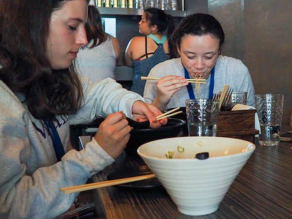 Two females eating ramen