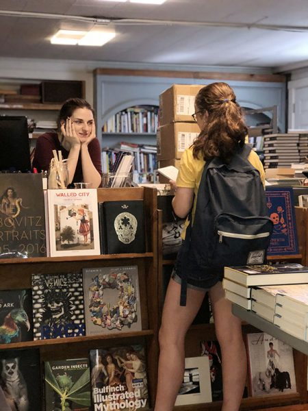 Girl interviewing a subject at bookends and beginnings
