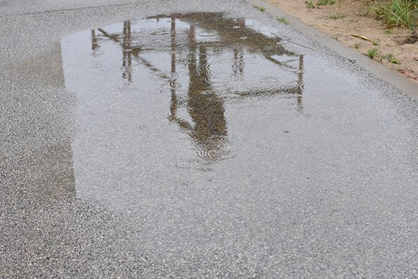 A puddle with a reflection.