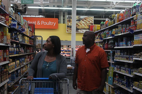 A man and woman shop at a grocery store.